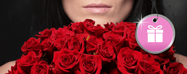 Woman with a big bunch of red roses in front of her