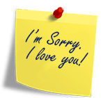 Yellow post-it note with I'm sorry and I love you written on it