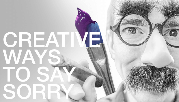 Man wearing Groucho Marx glasses and mustache holding a cigar with a paintbrush with purple paint