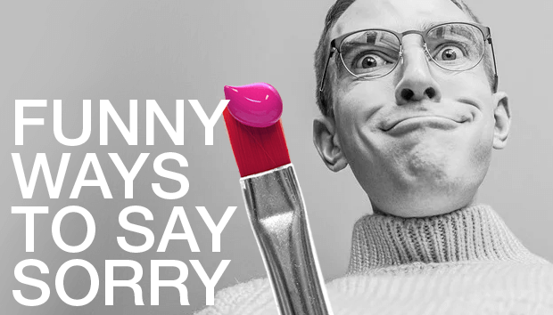 Man wearing glasses making a goofy face while holding a paintbrush with pink paint